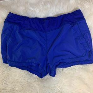Athleta royal blue running game shorts, XL